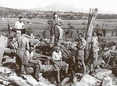 FSU examining German dugouts, Gustav Line. G Wooler