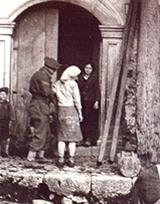 Girl with GI kit bag as a skirt, Pantelleria. G Wooler