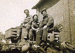 3 members of 2 Troop, 'A' Squadron on a Cromwell turret. CT is the trooper in the middle.