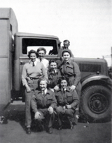 Peggie Stead, centre, with colleagues and her lorry at RAF Marham.